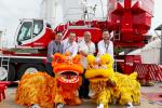 Alan Kan (Set Win Motors Ltd.), Christoph Kleiner (Liebherr-Werk Ehingen GmbH), Raymond Kan (Set Win Motors Ltd.) and Andreas Ganahl (Liebherr (HKG) Limited) prior to the festive lion dance during the Liebherr Customer Day in Hong Kong